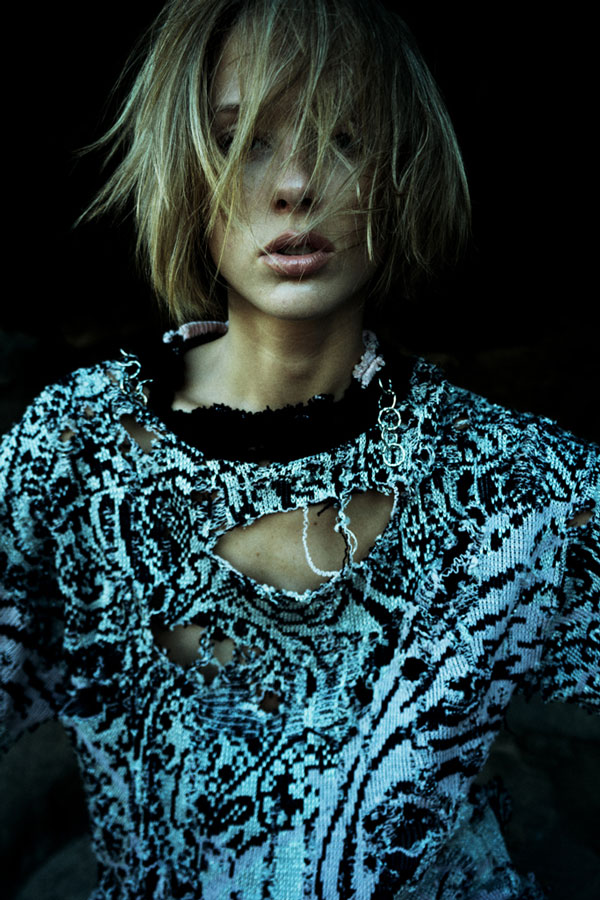Kesler-Tran-shredded-sweater