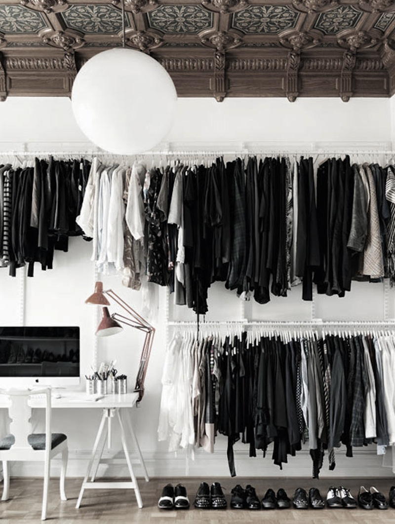 clothes rack white brown wall